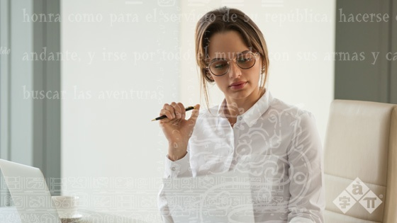 serious-female-boss-reading-document-analyzing-statistics